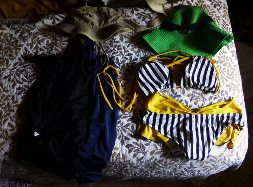 Two sensible Speedo one pieces with a boonie hat, and a cute Fables by Barrie bikini with a Ralph Lauren hat.